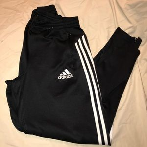 Adidas pants with zippered ankles and pockets